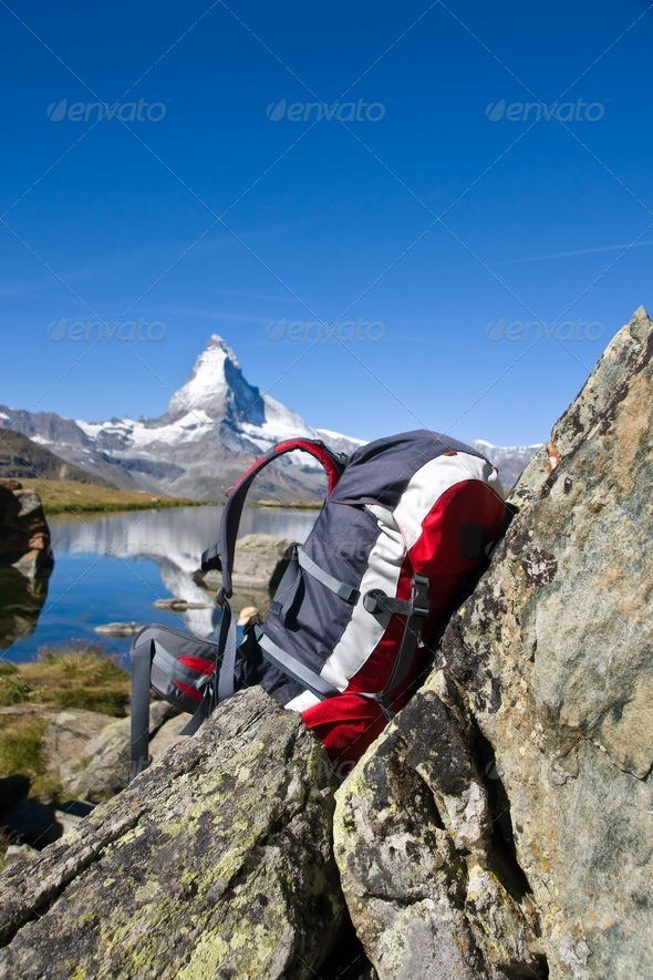 Backpack in front of the Matterhorn - Stock Photo - Images