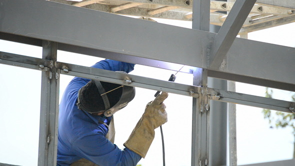 Welder Working In Welding Beams In A Building Stru By