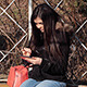 Girl Playing on Digital Tablet Outdoors - VideoHive Item for Sale