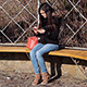 Young Woman Using Tablet on Park Bench - VideoHive Item for Sale