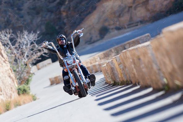 riding a chopper motorcycle - Stock Photo - Images