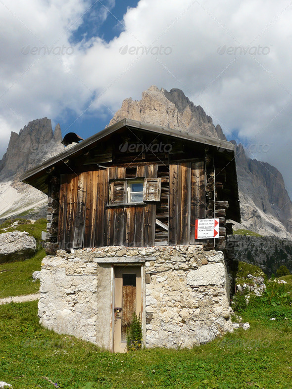 Wooden log cabin in the Dolomites - Stock Photo - Images