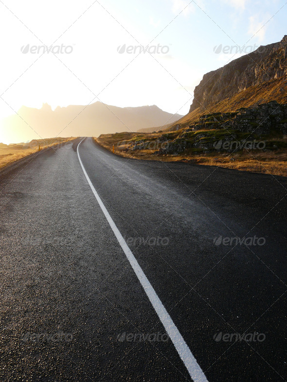 Wet road in Iceland - Stock Photo - Images