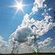 Tall Electric Masts Against Sun And Cloudy Sky - VideoHive Item for Sale