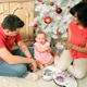 Young Happy Joyful Family With Christmas Gift  - VideoHive Item for Sale
