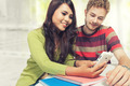 Young couple multi ethnic study together