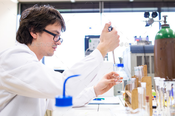 Male researcher carrying out scientific research in a lab (shall - Stock Photo - Images