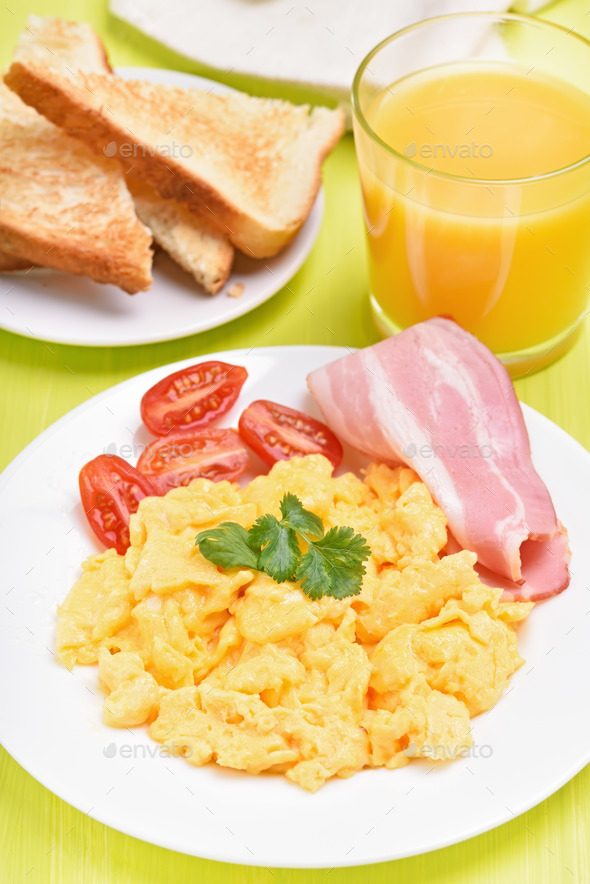 Scrambled eggs with bacon and tomatoes - Stock Photo - Images