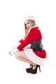 Portrait Of Pretty Young Woman In Santa Costume Smiling Over White Background - PhotoDune Item for Sale