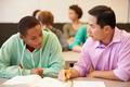 High School Teacher Helping Student With Written Work - PhotoDune Item for Sale