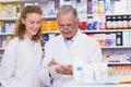 Pharmacists writing a prescription at hospital pharmacy