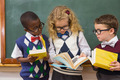 Pupils reading books at elementary school - PhotoDune Item for Sale