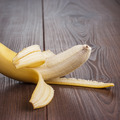 Fresh Peeled Banana On The Brown Background - PhotoDune Item for Sale