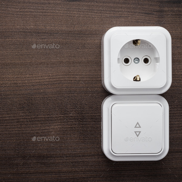 Switch And Outlet On The Wall - Stock Photo - Images