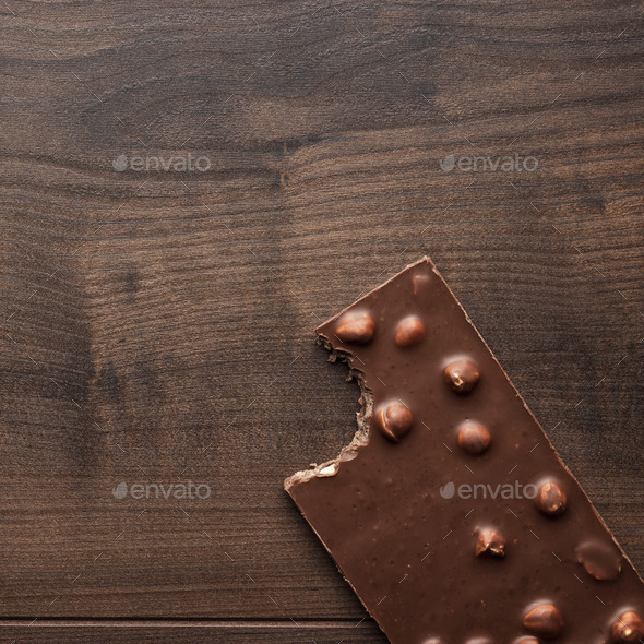 Nibbled Chocolate Bar With Whole Hazelnuts - Stock Photo - Images