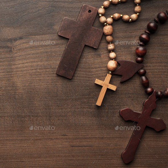 Crosses Over Brown Wooden Background - Stock Photo - Images