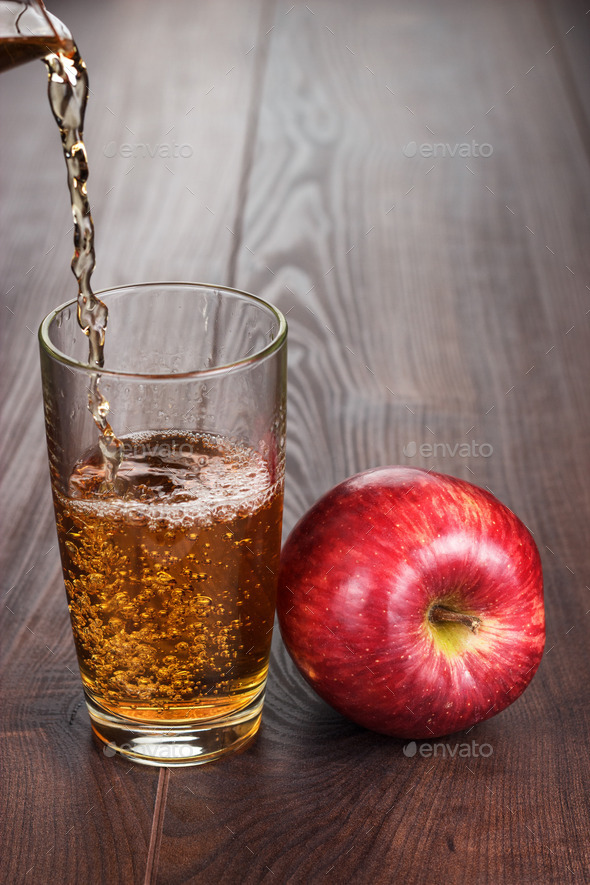 fresh apple juice pouring into glass stock photo by garloon photodune
