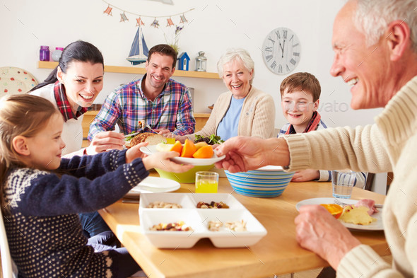 Multi Generation Family Eating Lunch At Kitchen Table - Stock Photo - Images