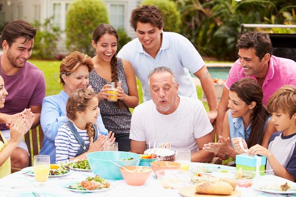 Multi Generation Family Celebrating Birthday In Garden - Stock Photo - Images