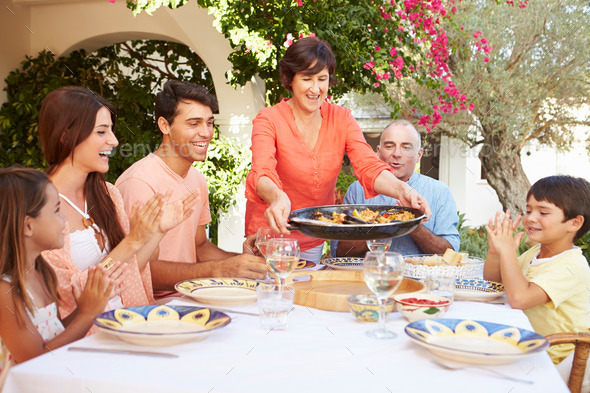Multi Generation Family Enjoying Meal On Terrace Together - Stock Photo - Images