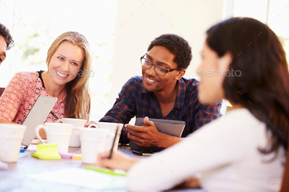 Group Of Business People Sitting Around Table In Meeting - Stock Photo - Images