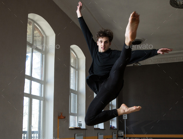 Young male dancer jumping at gym - Stock Photo - Images