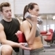 Young Couple With Dumbbell Flexing Muscles In Gym - VideoHive Item for Sale
