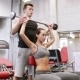 Man And Woman With Barbell Flexing Muscles In Gym - VideoHive Item for Sale