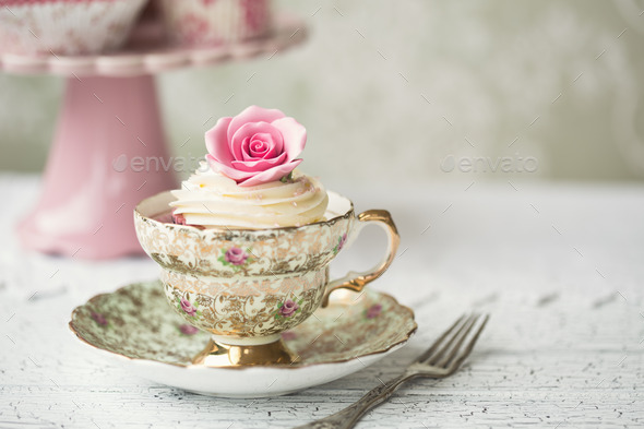 Cupcake in a vintage teacup - Stock Photo - Images