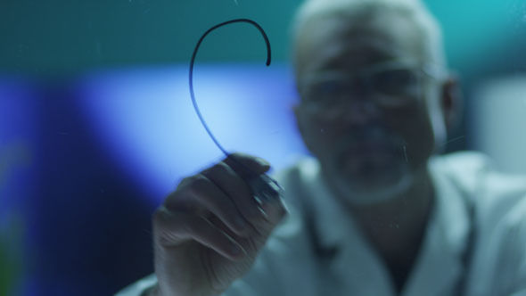 Scientist is Drawing Heart with Marker on Glass by Gorodenkoffs ...