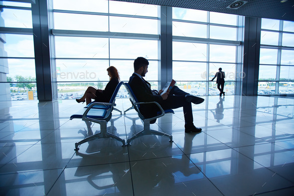 Businesspeople in airport - Stock Photo - Images