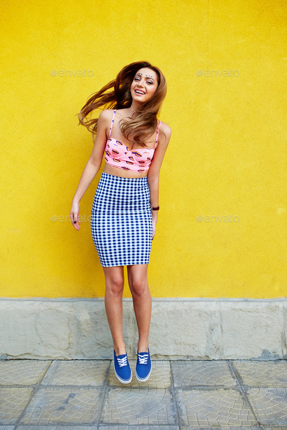 Attractive girl in an unusual skirt - Stock Photo - Images
