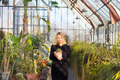 Florists woman working in greenhouse. - PhotoDune Item for Sale