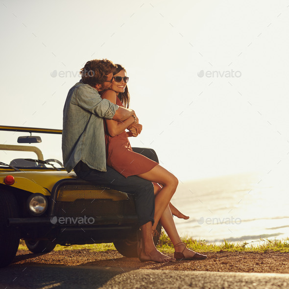 Romantic young couple on road trip - Stock Photo - Images