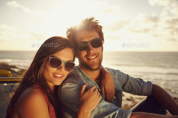 Beautiful young couple on a road trip - Stock Photo - Images
