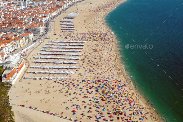 Beach life in Nazare, Portugal  - Stock Photo - Images