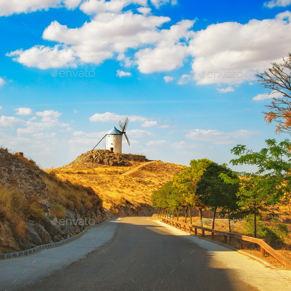Windmill of Don Quixote and road in Consuegra. Castile La Mancha - Stock Photo - Images