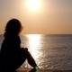 Silhouette Of a Woman Relaxing On Beach At Sunset - VideoHive Item for Sale