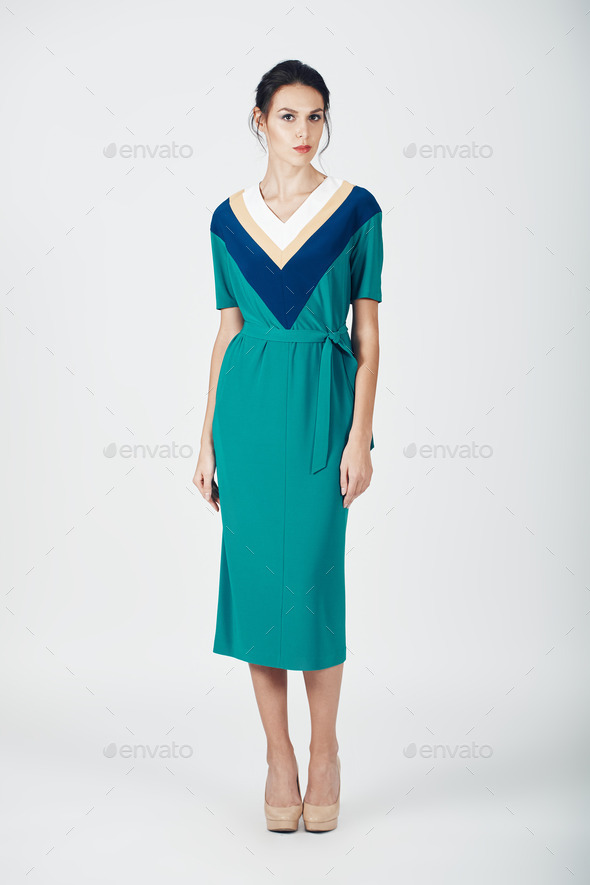 Fashion photo of young magnificent woman in a green dress - Stock Photo - Images