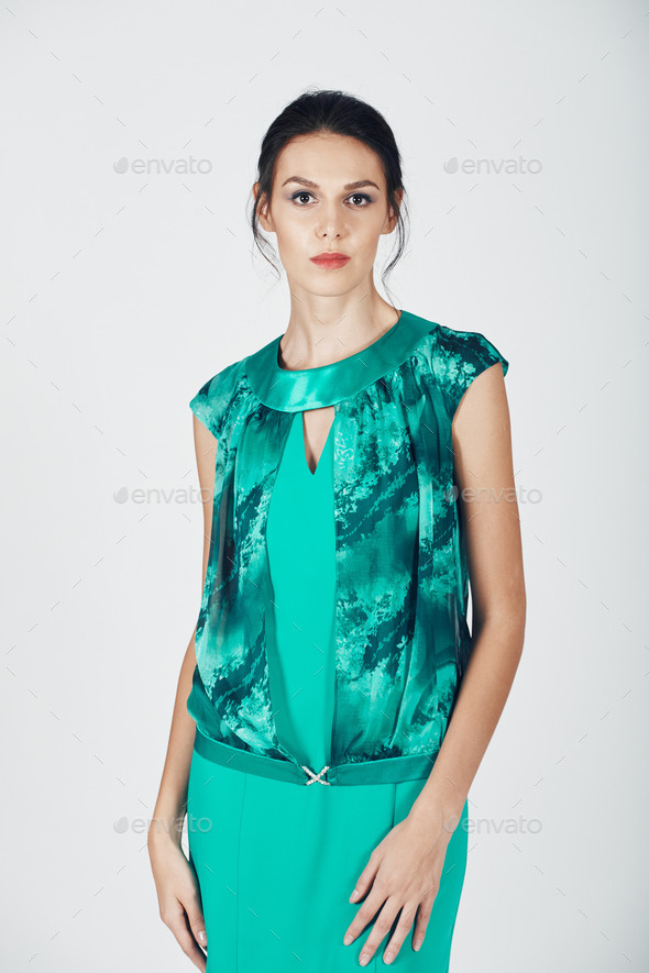Fashion photo of young magnificent woman in a turquoise dress - Stock Photo - Images
