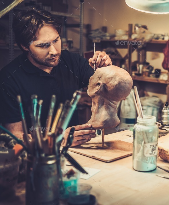 Man working in a prosthetic special fx workshop - Stock Photo - Images