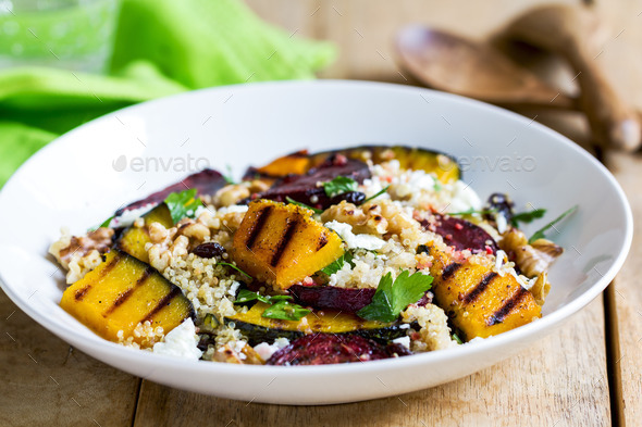 Quinoa with grilled pumpkin and beetroot salad - Stock Photo - Images