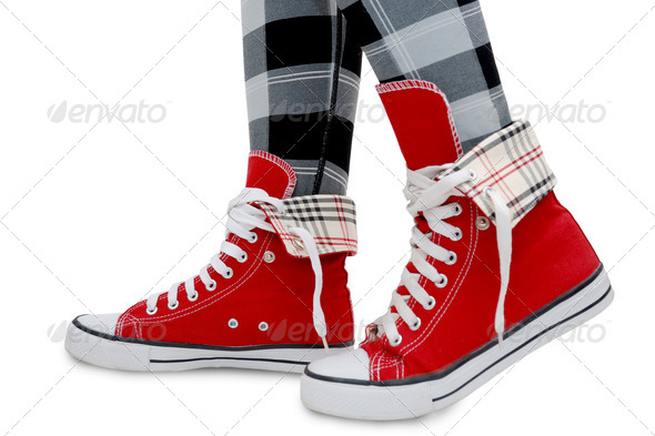 Red sneakers, checkered leggings. - Stock Photo - Images