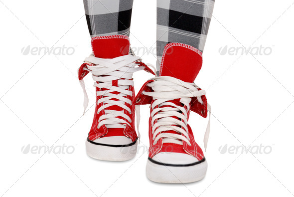 Red sneakers, checkered leggings. Isolated over white. - Stock Photo - Images