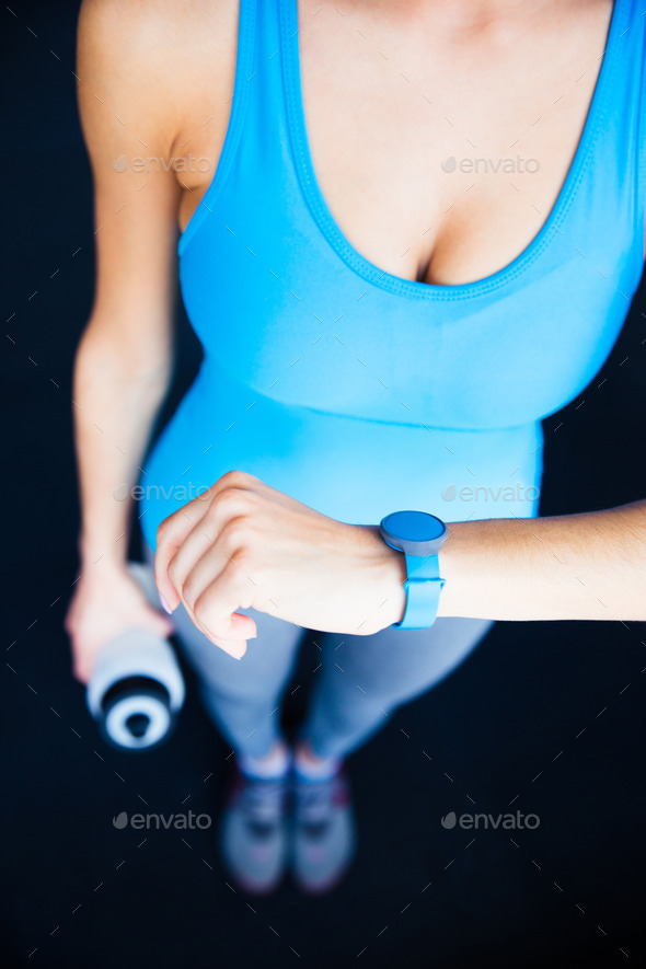 Closeup image of a woman with activity tracker - Stock Photo - Images