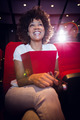 Smiling young woman watching a film at the cinema - PhotoDune Item for Sale