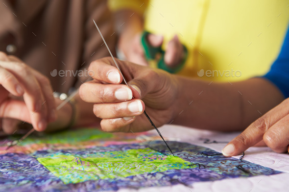 Close Up Of Woman's Hand Sewing Quilt - Stock Photo - Images