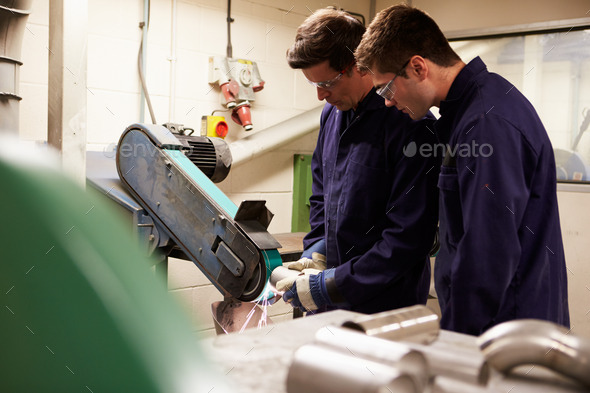 Engineer Teaching Apprentice To Use Grinding Machine - Stock Photo - Images