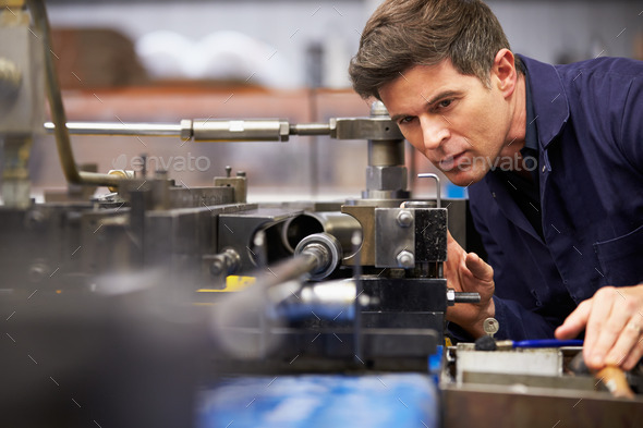 Factory Engineer Operating Hydraulic Tube Bender - Stock Photo - Images
