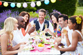 Group Of Friends Enjoying Outdoor Dinner Party - PhotoDune Item for Sale